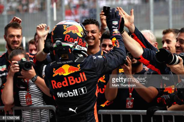 Daniel Ricciardo of Australia and Red Bull Racing celebrates finishing in third place with his team in parc ferme during the Formula One Grand Prix...