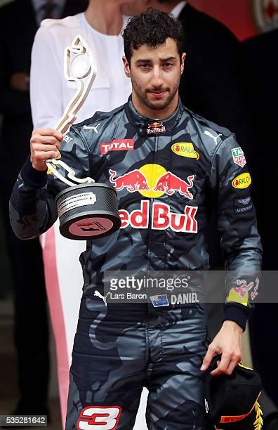 Daniel Ricciardo of Australia and Red Bull Racing celebrates on the podium during the Monaco Formula One Grand Prix at Circuit de Monaco on May 29...