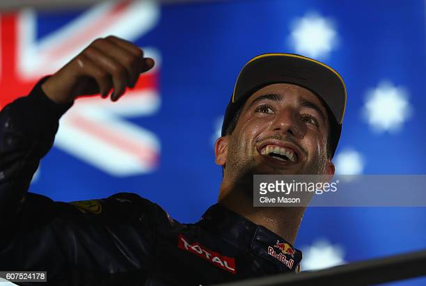 Daniel Ricciardo of Australia and Red Bull Racing celebrates on the podium during the Formula One Grand Prix of Singapore at Marina Bay Street...