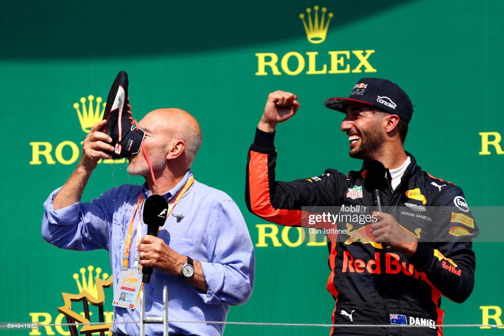 Daniel Ricciardo of Australia and Red Bull Racing celebrates on the podium with Patrick Stewart and a shoey after finishing third in the Canadian Formula One Grand Prix at Circuit Gilles Villeneuve on June 11, 2017 in Montreal, Canada.