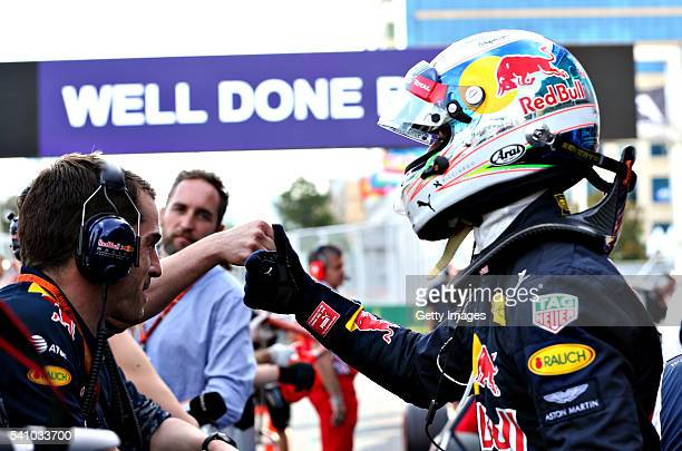 Daniel Ricciardo of Australia and Red Bull Racing celebrates with his team in parc ferme after qualifying for the European Formula One Grand Prix at...