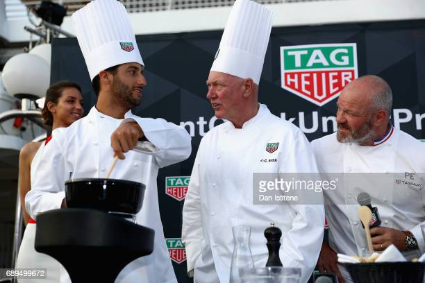 Daniel Ricciardo of Australia and Red Bull Racing Chef Philippe Etchebest and TAG Heuer CEO JeanClaude Biver at the TAG Heuer Culinary Challenge on...