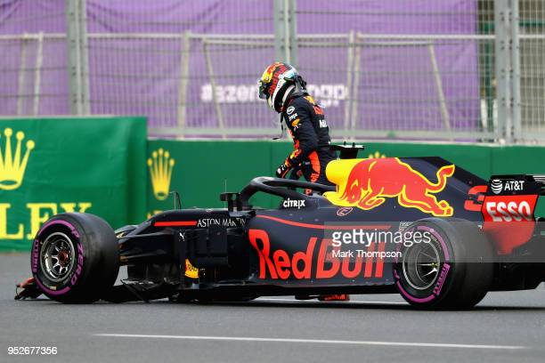 Daniel Ricciardo of Australia and Red Bull Racing climbs from his car after crashing during the Azerbaijan Formula One Grand Prix at Baku City...