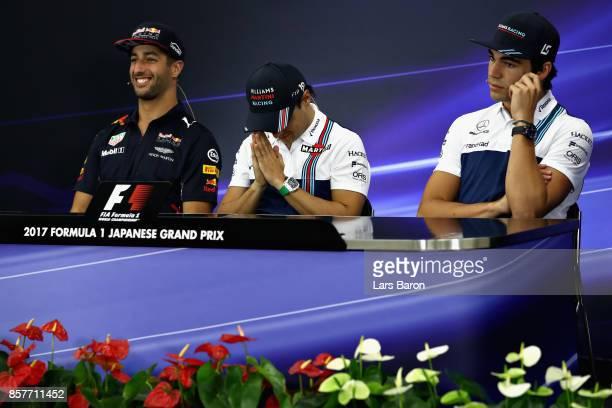 Daniel Ricciardo of Australia and Red Bull Racing, Felipe Massa of Brazil and Williams and Lance Stroll of Canada and Williams in the Drivers Press...