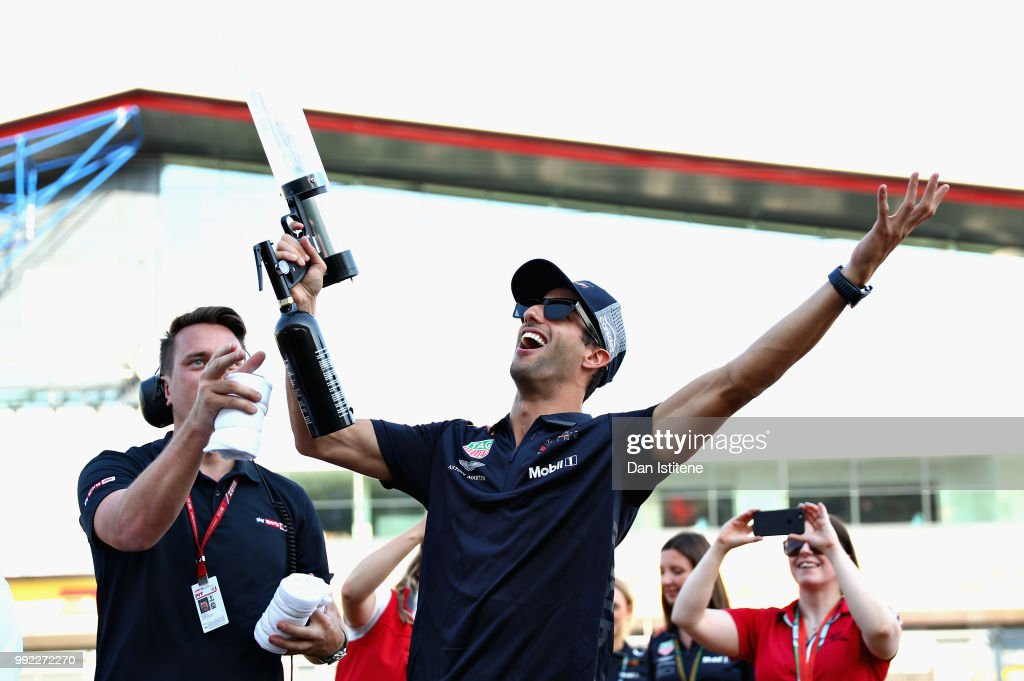 Daniel Ricciardo of Australia and Red Bull Racing fires tshirts into the crowd during previews ahead of the Formula One Grand Prix of Great Britain at Silverstone on July 5, 2018 in Northampton, England.