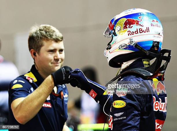 Daniel Ricciardo of Australia and Red Bull Racing fist bumps a Red Bull Racing team member in parc ferme after qualifying in second position during...