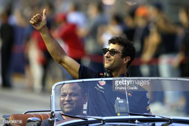 Daniel Ricciardo of Australia and Red Bull Racing gives the crowd a thumbs up on the drivers parade before the Formula One Grand Prix of Singapore at...