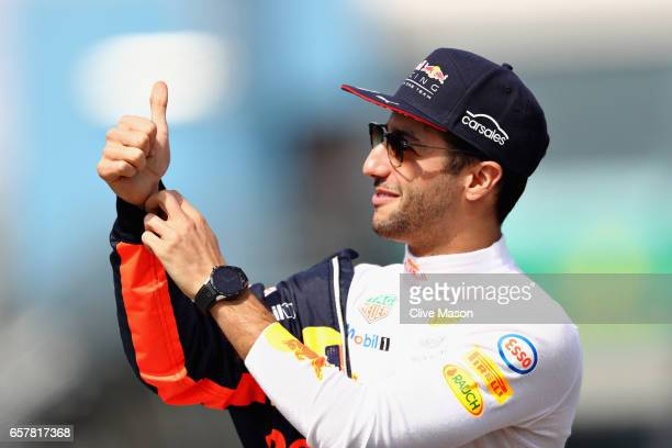Daniel Ricciardo of Australia and Red Bull Racing gives the crowd a thumbs up on the drivers parade before the Australian Formula One Grand Prix at...