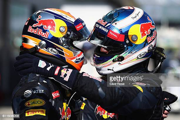 Daniel Ricciardo of Australia and Red Bull Racing is congratulated by Max Verstappen of Netherlands and Red Bull Racing in parc ferme during the...