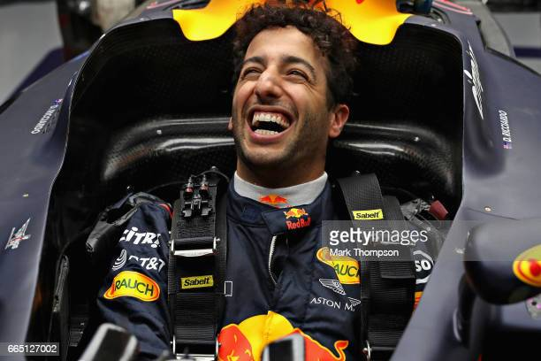 Daniel Ricciardo of Australia and Red Bull Racing laughs during a seat fitting in the garage during previews to the Formula One Grand Prix of China...