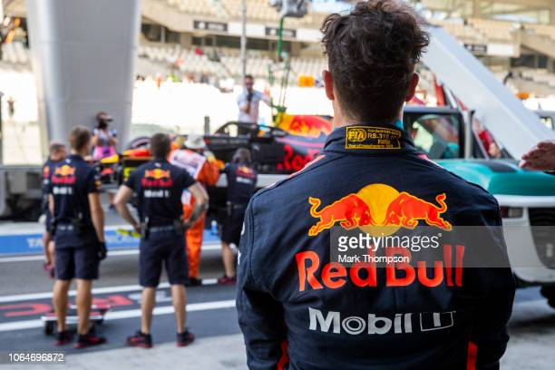 Daniel Ricciardo of Australia and Red Bull Racing looks on as his car is removed from a truck after stopping during final practice for the Abu Dhabi...