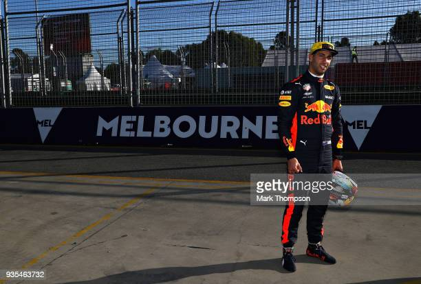 Daniel Ricciardo of Australia and Red Bull Racing looks on at the circuit during previews ahead of the Australian Formula One Grand Prix at Albert...