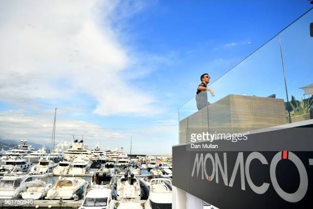 Daniel Ricciardo of Australia and Red Bull Racing looks on from the Red Bull Racing Energy Station during previews ahead of the Monaco Formula One...