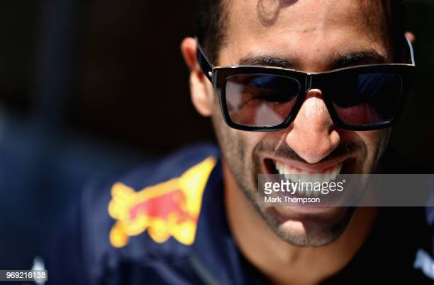 Daniel Ricciardo of Australia and Red Bull Racing looks on in the Paddock during previews ahead of the Canadian Formula One Grand Prix at Circuit...