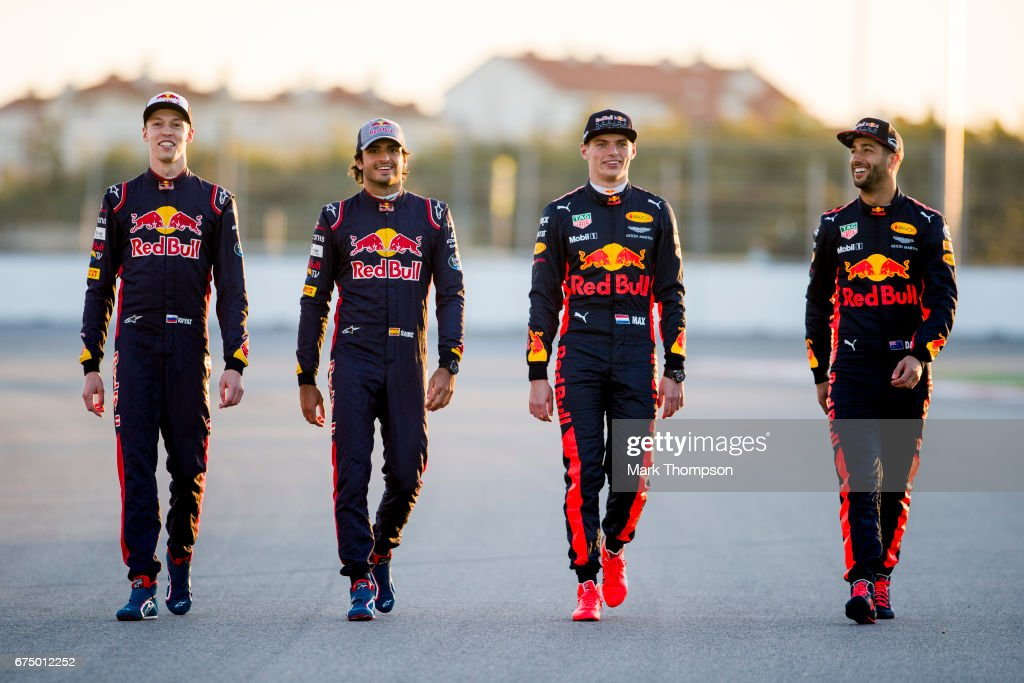 Daniel Ricciardo of Australia and Red Bull Racing, Max Verstappen of Netherlands and Red Bull Racing, Carlos Sainz of Spain and Scuderia Toro Rosso and Daniil Kvyat of Russia and Scuderia Toro Rosso pose for a photo during previews to the Formula One Grand Prix of Russia on April 27, 2017 in Sochi, Russia.