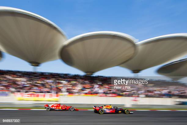 Daniel Ricciardo of Australia and Red Bull Racing overatke Sebastian Vettel of Ferrari and Germany during the Formula One Grand Prix of China at...