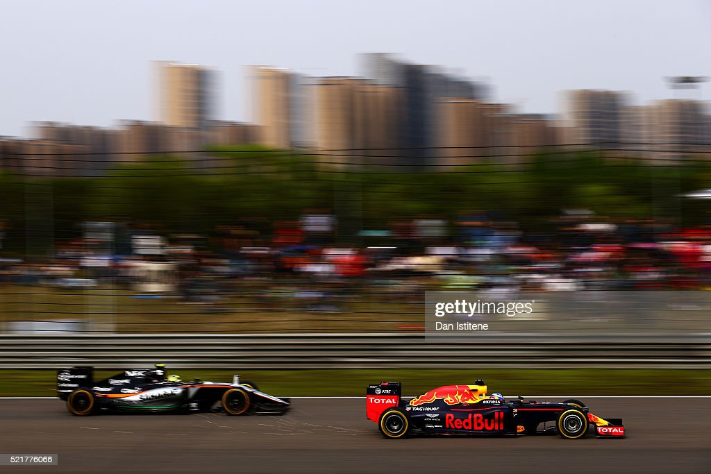 Daniel Ricciardo of Australia and Red Bull Racing overtakes Sergio Perez of Mexico and Force India during the Formula One Grand Prix of China at Shanghai International Circuit on April 17, 2016 in Shanghai, China.