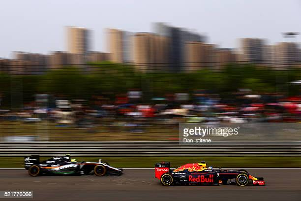 Daniel Ricciardo of Australia and Red Bull Racing overtakes Sergio Perez of Mexico and Force India during the Formula One Grand Prix of China at...