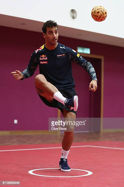 Daniel Ricciardo of Australia and Red Bull Racing plays Malaysian sport sepak takraw at the iM4U Sentral in Puchong during previews for the Malaysia...