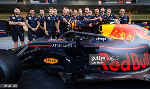 Daniel Ricciardo of Australia and Red Bull Racing poses for a photo with his team in the Pitlane during previews ahead of the Abu Dhabi Formula One...