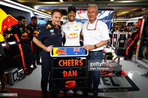 Daniel Ricciardo of Australia and Red Bull Racing poses for a photo with Red Bull Racing Team Principal Christian Horner and Red Bull Racing Team...