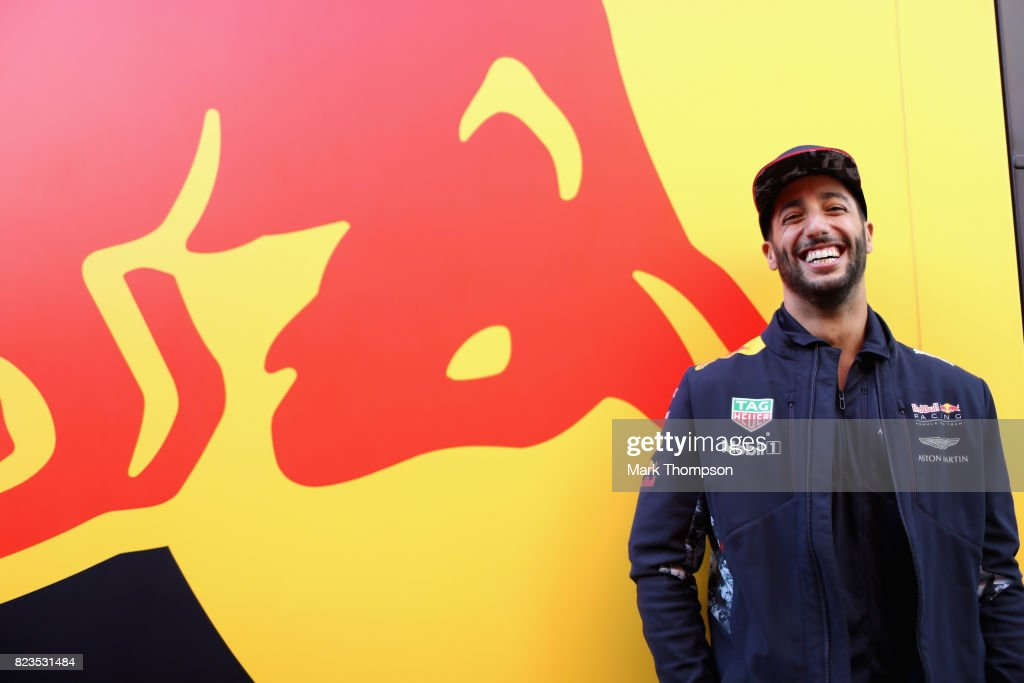 Daniel Ricciardo of Australia and Red Bull Racing poses for a photo next to a Red Bull Racing truck in the Paddock during previews ahead of the Formula One Grand Prix of Hungary at Hungaroring on July 27, 2017 in Budapest, Hungary.