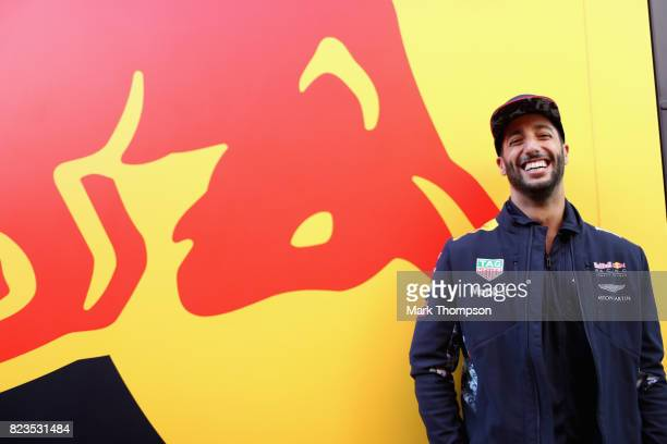 Daniel Ricciardo of Australia and Red Bull Racing poses for a photo next to a Red Bull Racing truck in the Paddock during previews ahead of the...