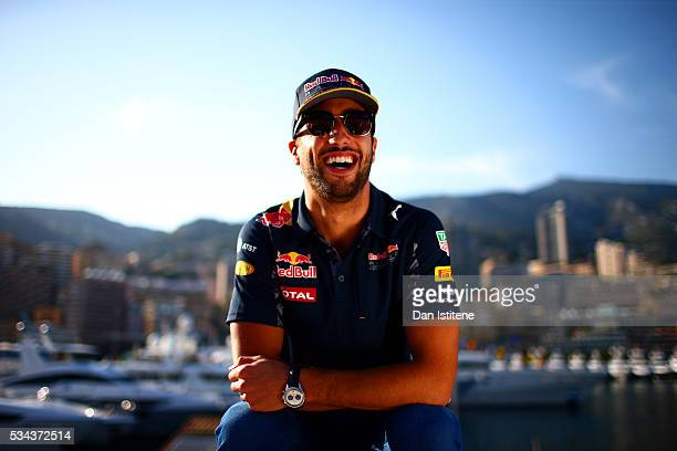 Daniel Ricciardo of Australia and Red Bull Racing poses on the Red Bull Energy Station during previews to the Monaco Formula One Grand Prix at...