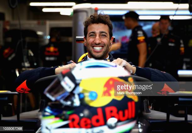 Daniel Ricciardo of Australia and Red Bull Racing prepares to drive in the garage during practice for the Formula One Grand Prix of Singapore at...