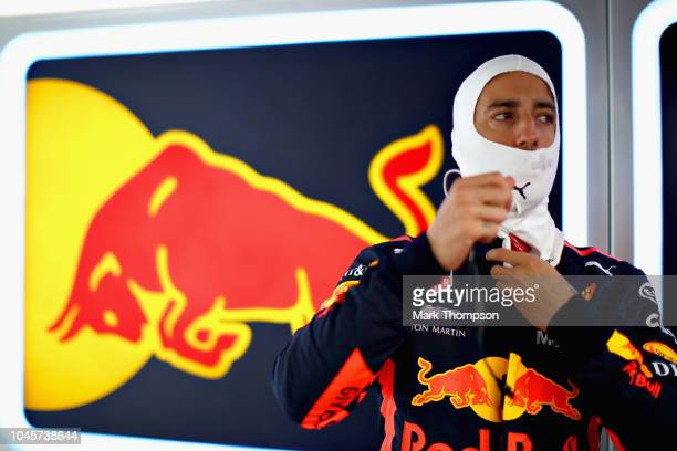 Daniel Ricciardo of Australia and Red Bull Racing prepares to drive in the garage during practice for the Formula One Grand Prix of Japan at Suzuka...