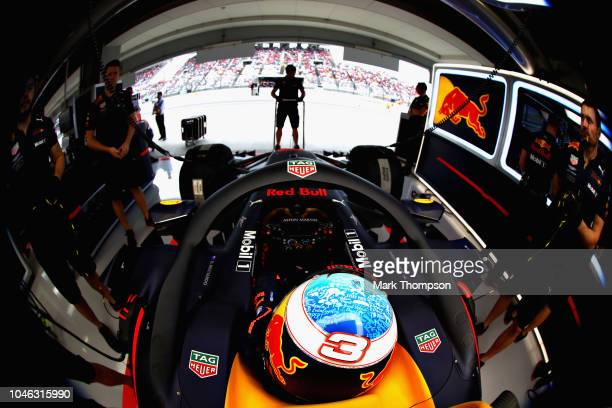 Daniel Ricciardo of Australia and Red Bull Racing prepares to drive in the garage during qualifying for the Formula One Grand Prix of Japan at Suzuka...