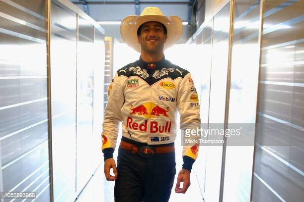 Daniel Ricciardo of Australia and Red Bull Racing prepares to drive in the garage before the United States Formula One Grand Prix at Circuit of The...