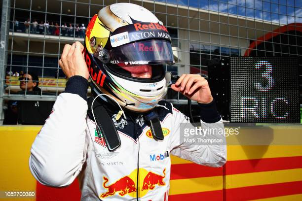 Daniel Ricciardo of Australia and Red Bull Racing prepares to drive on the grid before the United States Formula One Grand Prix at Circuit of The...