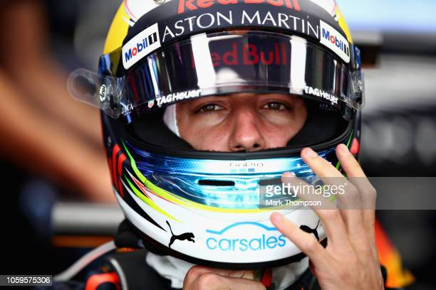 Daniel Ricciardo of Australia and Red Bull Racing prepares to drive in the garage during practice for the Formula One Grand Prix of Brazil at...
