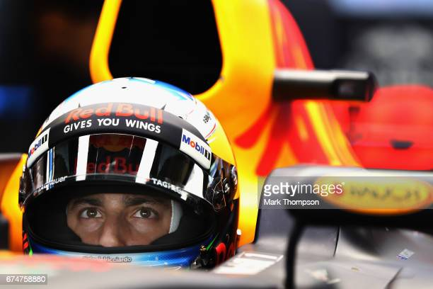 Daniel Ricciardo of Australia and Red Bull Racing prepares to drive in the garage during qualifying for the Formula One Grand Prix of Russia on April...