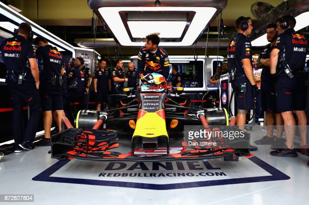 Daniel Ricciardo of Australia and Red Bull Racing prepares to drive in the garage during final practice for the Formula One Grand Prix of Brazil at...
