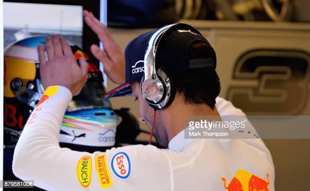 Daniel Ricciardo of Australia and Red Bull Racing prepares to drive in the garage before the Abu Dhabi Formula One Grand Prix at Yas Marina Circuit...