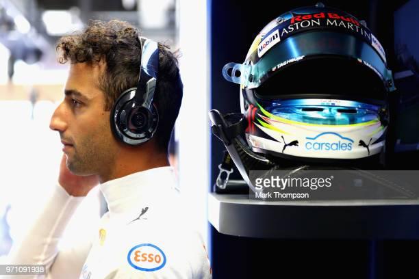 Daniel Ricciardo of Australia and Red Bull Racing prepares to drive in the garage before the Canadian Formula One Grand Prix at Circuit Gilles...