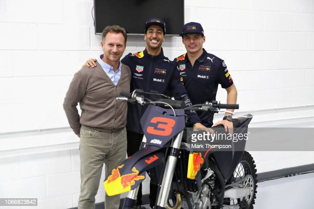 Daniel Ricciardo of Australia and Red Bull Racing Red Bull Racing Team Principal Christian Horner and Max Verstappen of Netherlands and Red Bull...