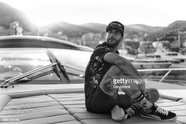 Daniel Ricciardo of Australia and Red Bull Racing relaxes on a boat during qualifying for the Monaco Formula One Grand Prix at Circuit de Monaco on...