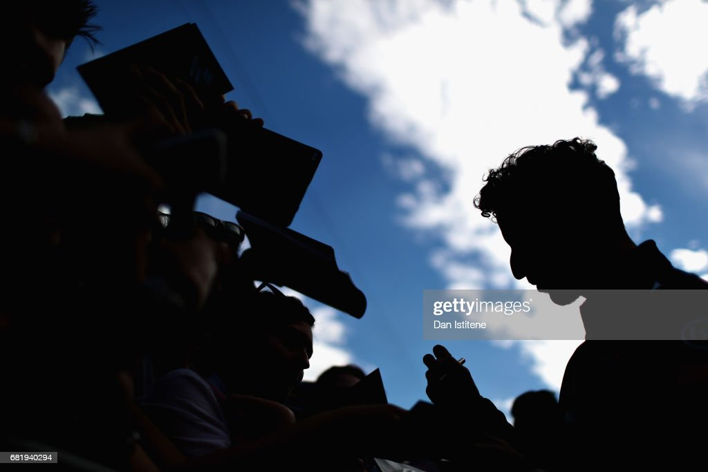 Daniel Ricciardo of Australia and Red Bull Racing signs autographs for fans during previews for the Spanish Formula One Grand Prix at Circuit de Catalunya on May 11, 2017 in Montmelo, Spain.