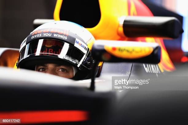 Daniel Ricciardo of Australia and Red Bull Racing sits in his car in the garage during day three of Formula One winter testing at Circuit de...