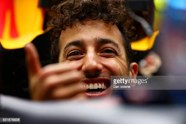 Daniel Ricciardo of Australia and Red Bull Racing smiles as he sits in his car in the garage during day one of Formula One testing at Circuit de...