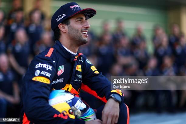 Daniel Ricciardo of Australia and Red Bull Racing smiles at the Red Bull Racing team photo before the Abu Dhabi Formula One Grand Prix at Yas Marina...