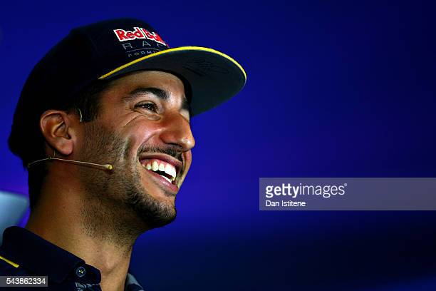 Daniel Ricciardo of Australia and Red Bull Racing smiles in the Drivers Press Conference during previews ahead of the Formula One Grand Prix of...