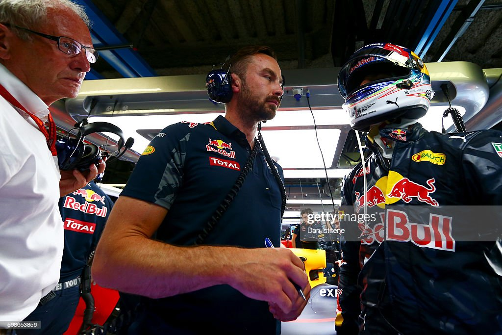 Daniel Ricciardo of Australia and Red Bull Racing speaks with his race engineer Simon Rennie and Red Bull Racing Team Consultant Dr Helmut Marko in the garage during practice for the Formula One Grand Prix of Italy at Autodromo di Monza on September 2, 2016 in Monza, Italy.
