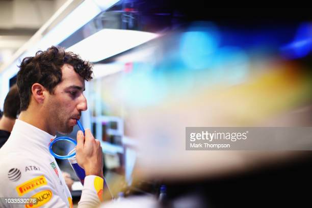 Daniel Ricciardo of Australia and Red Bull Racing takes a drink in the garage during final practice for the Formula One Grand Prix of Singapore at...