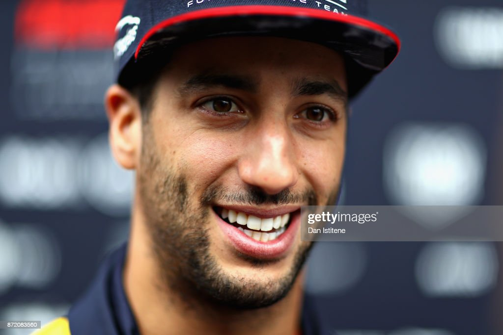 Daniel Ricciardo of Australia and Red Bull Racing talks in the Paddock during previews for the Formula One Grand Prix of Brazil at Autodromo Jose Carlos Pace on November 9, 2017 in Sao Paulo, Brazil.