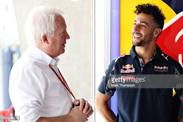 Daniel Ricciardo of Australia and Red Bull Racing talks to FIA Race Director Charlie Whiting in the garage during previews to the Formula One Grand...