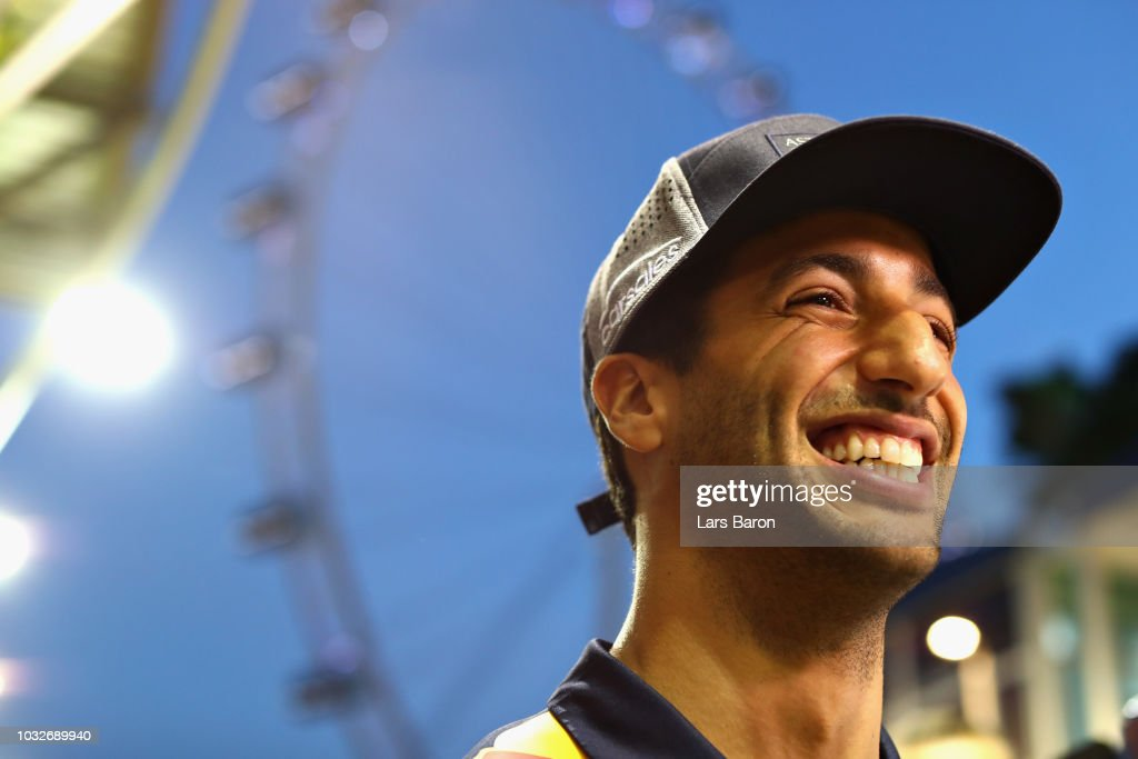 Daniel Ricciardo of Australia and Red Bull Racing talks to the media in the Paddock during previews ahead of the Formula One Grand Prix of Singapore at Marina Bay Street Circuit on September 13, 2018 in Singapore.